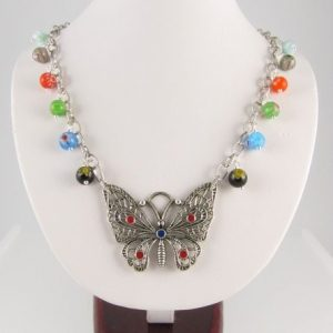Necklace with butterfly pendant and millefiori beads - copyright Helen White