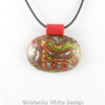 Oval Mokume Gane pendant in green - detail