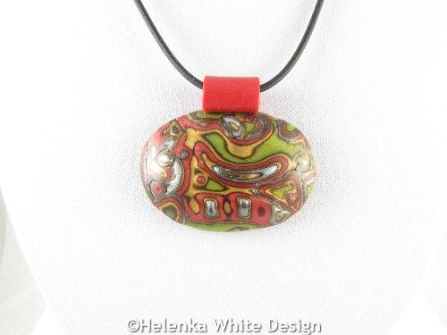 Oval Mokume Gane pendant in green - detail