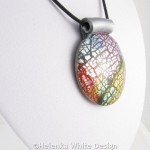 Colourful dichroic round pendant bust side