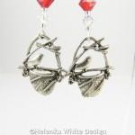 Bird in nest earrings in red - detail