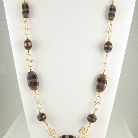 Necklace with purple bronze beads on bust