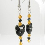 Cat face earrings in topaz and black