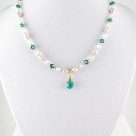 Emerald and gold necklace on bust