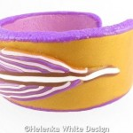 Gold and purple feather bangle - side