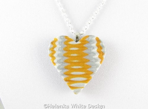 Gold and silver heart pendant -detail