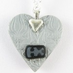 Silver and black heart pendant - back