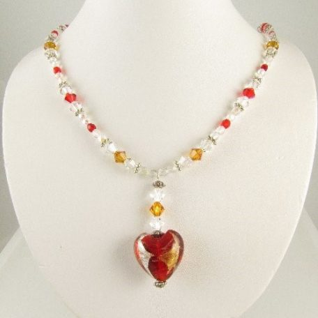 Red heart necklace on bust