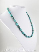 Turquoise necklace on bust side view