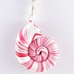 Red and white polymer clay nautilus pendant detail