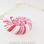 Red and white polymer clay nautilus pendant side 1