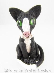 Black and white tomcat sculpture