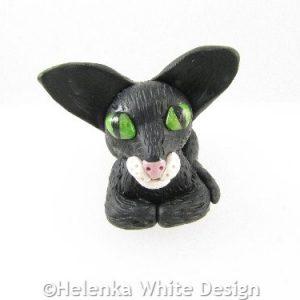 Sitting black cat sculpture