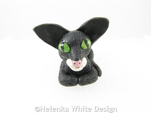 Sitting black cat sculpture
