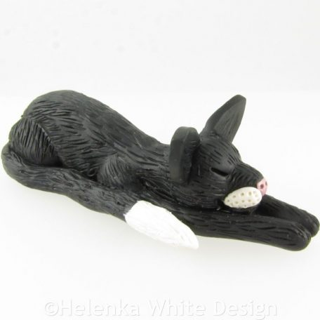 Stretched out black & white cat sculpture - side