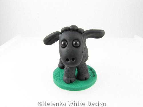 Black sheep sculpture