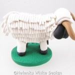 Valais Blacknose sheep with horns sculpture - side