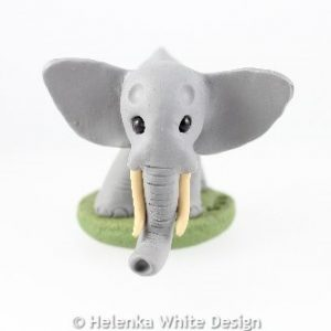 Elephant sculpture with tusks