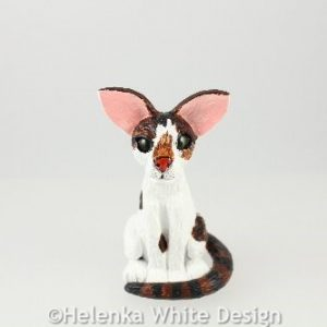White & tabby cat sculpture - front