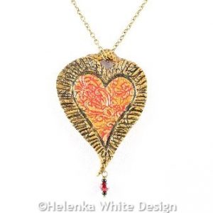 Big red heart pendant with Baroque motif