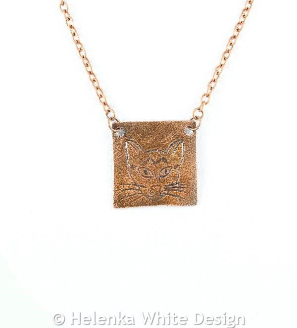 Copper cat face pendant