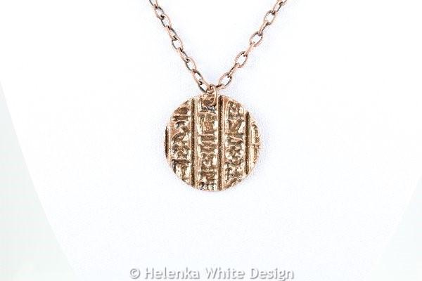 Hieroglyph copper pendant