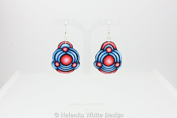 Big blue and red earrings.