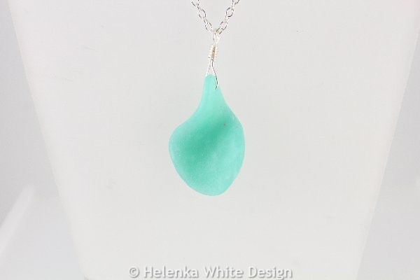 Curved faux beach glass pendant in green