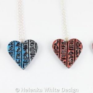 Hieroglyph heart pendants in the available colours