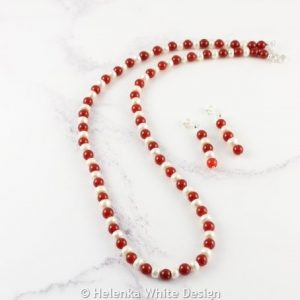 Red Agate necklace with freshwater rondelles and matching earrings.