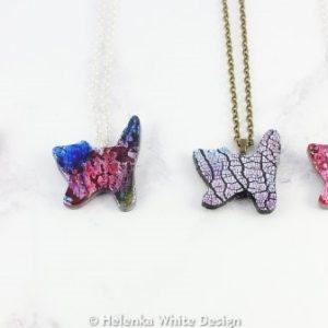 Faux dichroic standing cat pendants.