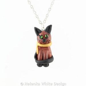 Sculpted sitting cat pendant - copper and black.