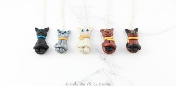 Sculpted sitting cat pendants in various colours