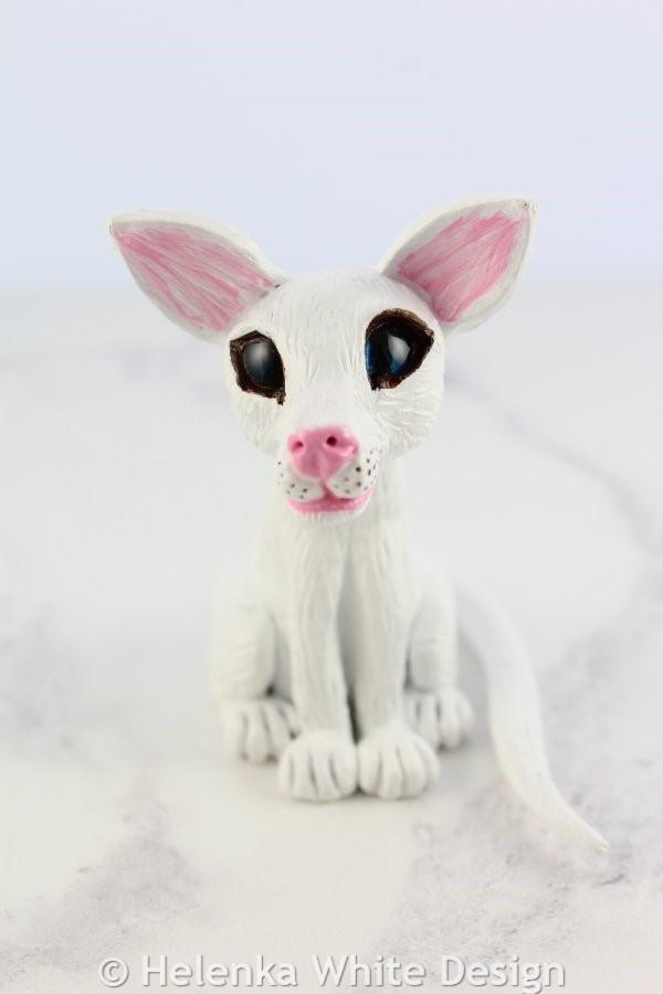 White cat sculpture - front